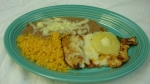 Pollo Acapulco - Grilled chicken breast seasoned with orange juice. Served with pineapple, cheese and tossed salad.